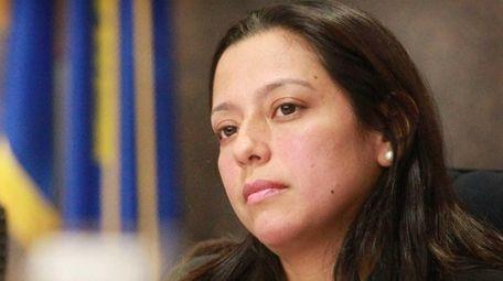 Suffolk County Legis. Monica Martinez listens at a
