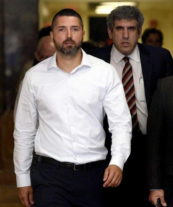 Wojciech Braszczok, left, exits a New York City