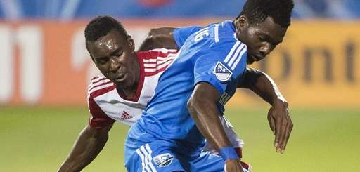 Montreal Impact's Ambroise Oyongo, right, challenges the New
