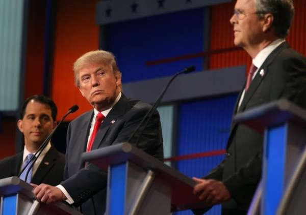 Republican presidential candidate Donald Trump looks toward Jeb