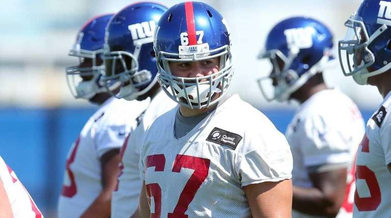 New York Giants tackle Justin Pugh looks on