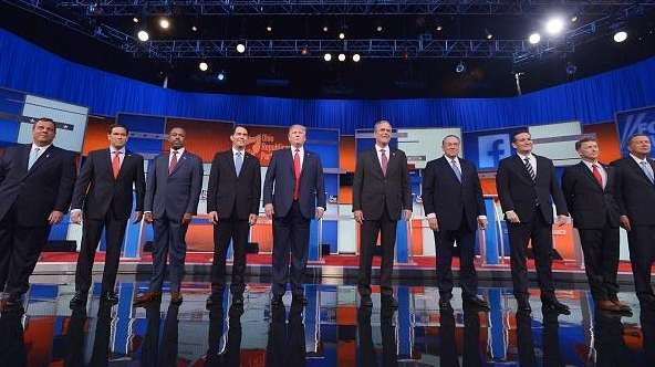 Republican presidential candidates arrive on stage for the