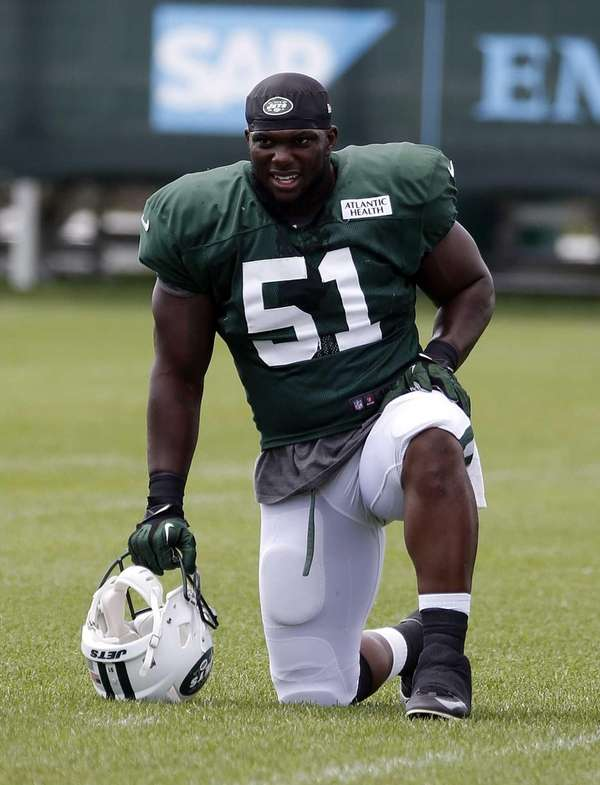 Jets outside linebacker Ikemefuna Enemkpali warms up at