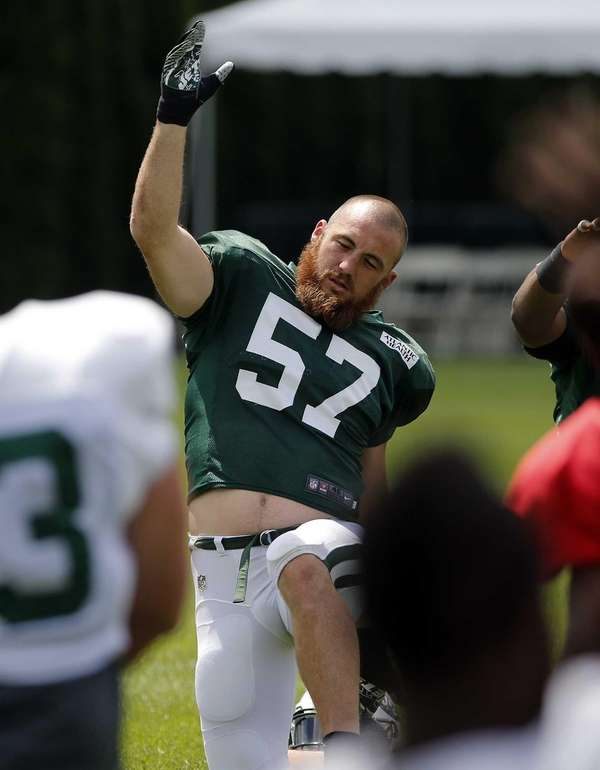 Jets outside linebacker Trevor Reilly stretches during warmups