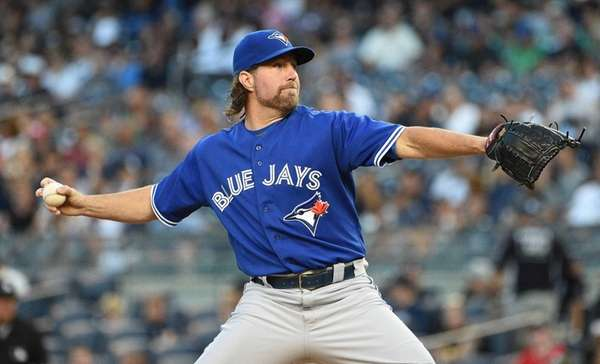 Toronto Blue Jays starting pitcher R.A. Dickey delivers