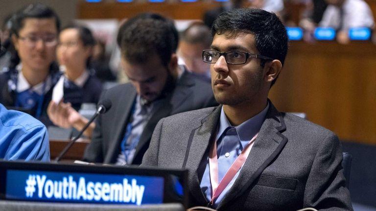 Ayyan Zubair, 18, of East Meadow listens to