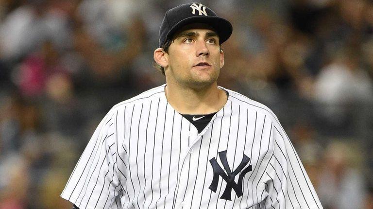 New York Yankees starting pitcher Nathan Eovaldi walks