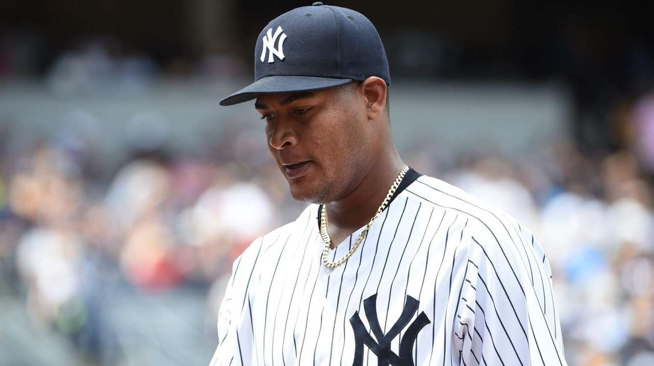 New York Yankees starting pitcher Ivan Nova walks