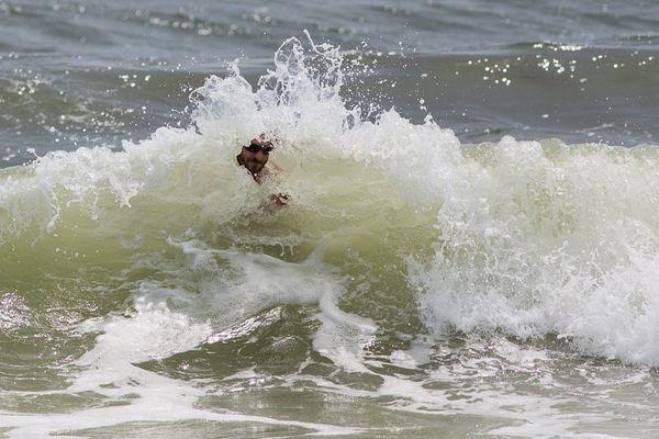 A man enjoys the water at Jones Beach