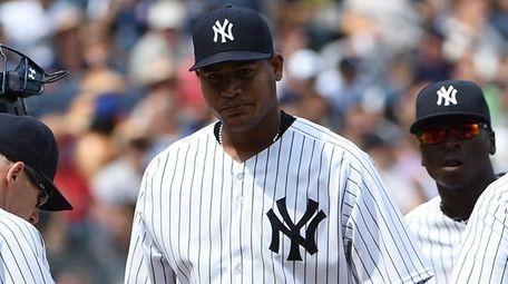 New York Yankees starting pitcher Ivan Nova walks