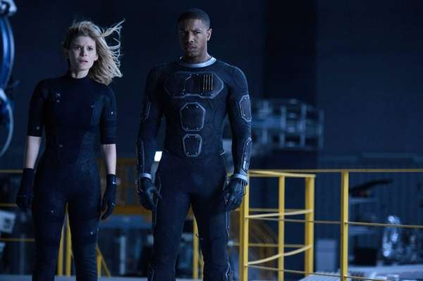 Kate Mara as Sue Storm and Michael B.