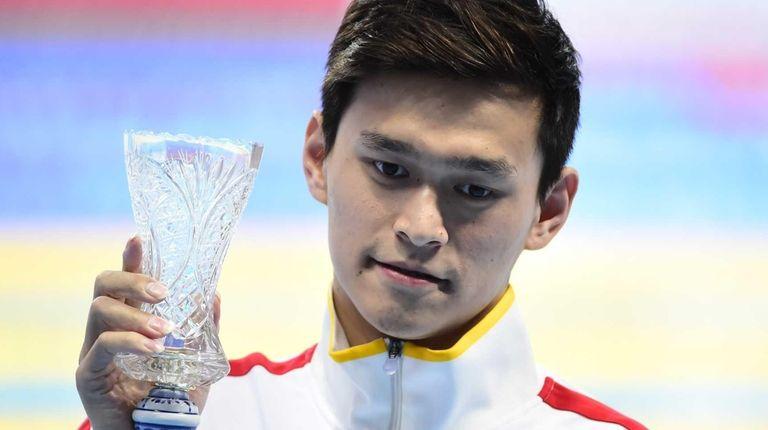 China's Sun Yang poses with his award for