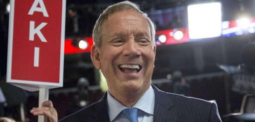 George Pataki, former governor of New York, laughs