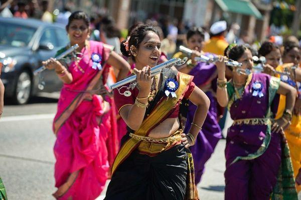Members of the Jallosh Dhol Tasha band perform