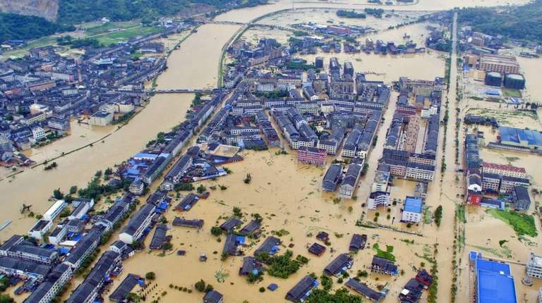 An aerial view shows a flooded town in