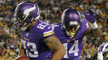 Minnesota Vikings tight end MyCole Pruitt, left celebrates