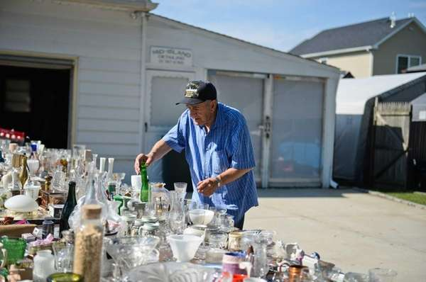 Joe Iannaco, of West Babylon, looks through items