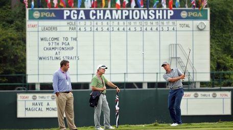 Jordan Spieth watches a shot alongside his agent