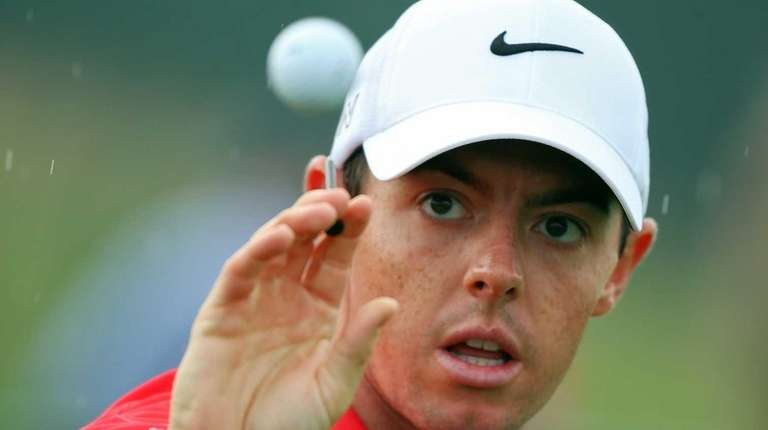 Rory McIlroy catches a ball while hitting a