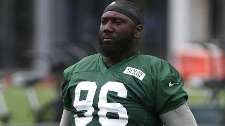 New York Jets defensive end Muhammad Wilkerson stretches