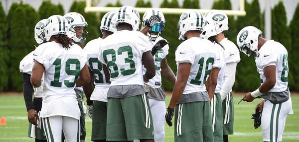 Members of the New York Jets offense huddle