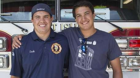 West Islip volunteer firefighters Jason Deak, 21, left,