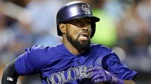 Jose Reyes #7 of the Colorado Rockies runs