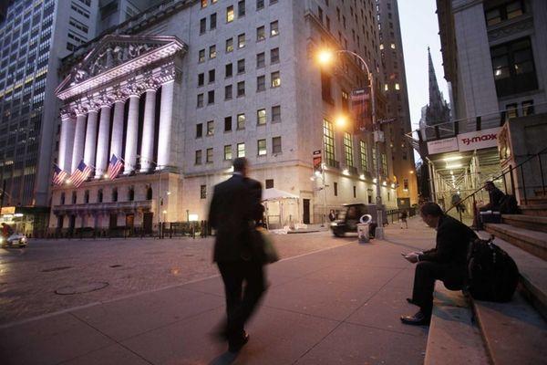 A man walks to work on Wall Street,