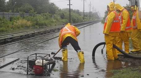 LIRR crews work on draining some flooding from