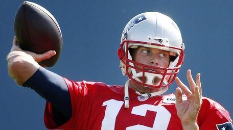 New England Patriots quarterback Tom Brady passes during