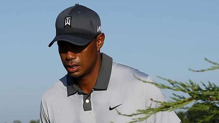 Tiger Woods walks to the second hole during
