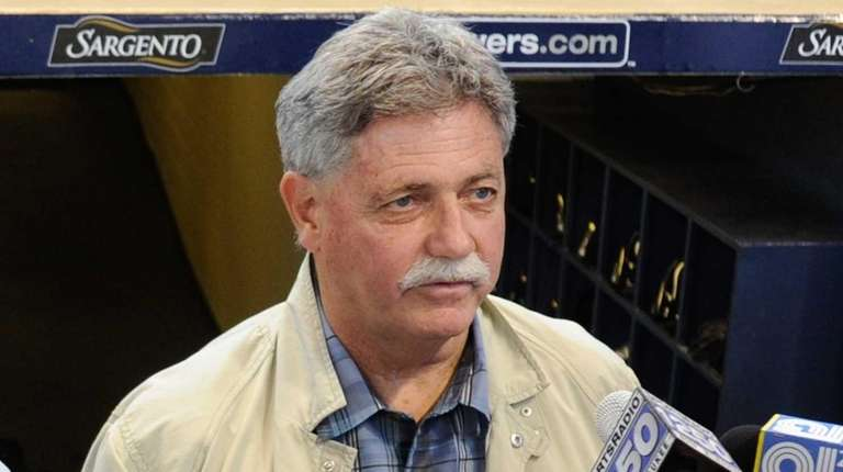 Milwaukee Brewers general manager Doug Melvin speaks to