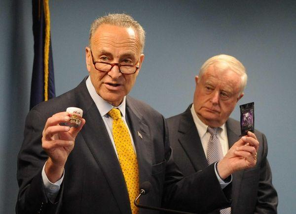 U.S. Senator Chuck Schumer holds up potpourri, left,