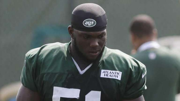 The New York Jets' Ikemefuna Enemkpali (51) listens