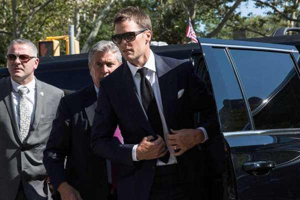New England Patriots quarterback Tom Brady arrives at
