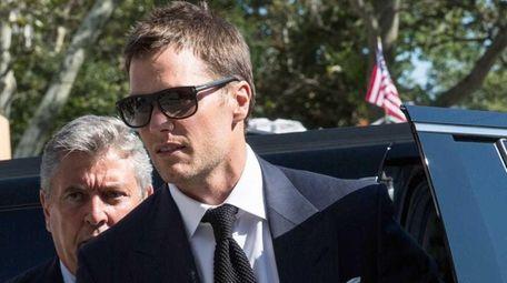 New England Patriots quarterback Tom Brady arrives at