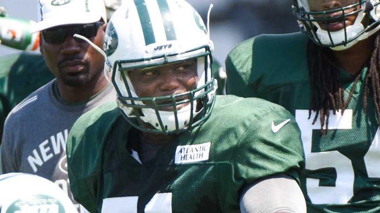 New York Jets linebacker Ikemefuna Enemkpali (51) looks