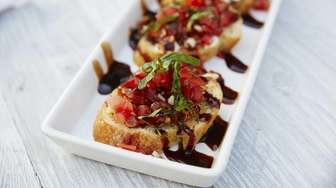 Bruschetta with tomatoes, basil and olive oil is