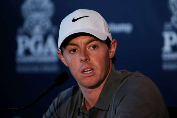 Rory McIlroy speaks to the media during a