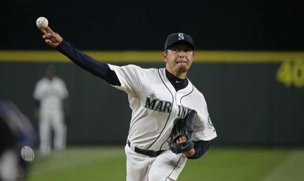 Seattle Mariners starting pitcher Hisashi Iwakuma delivers a