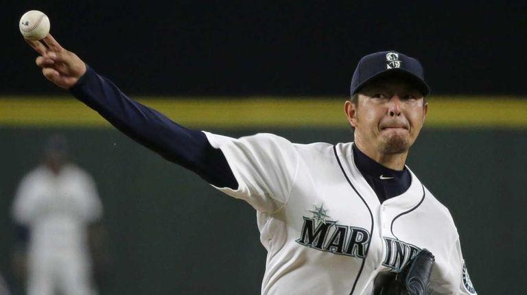 Seattle Mariners starting pitcher Hisashi Iwakuma delivers a