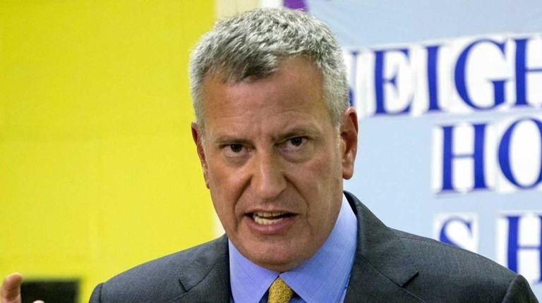 New York Mayor Bill de Blasio answers questions