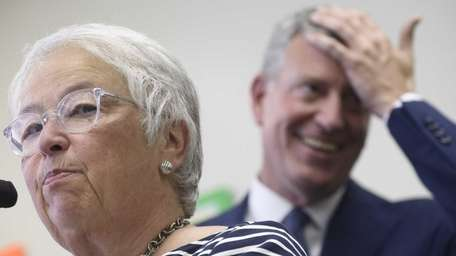 New York City Schools Chancellor Carmen Farina, left,