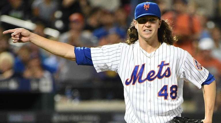 New York Mets starting pitcher Jacob deGrom reacts