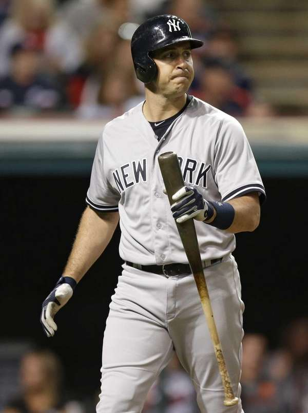 New York Yankees' Mark Teixeira walks back to