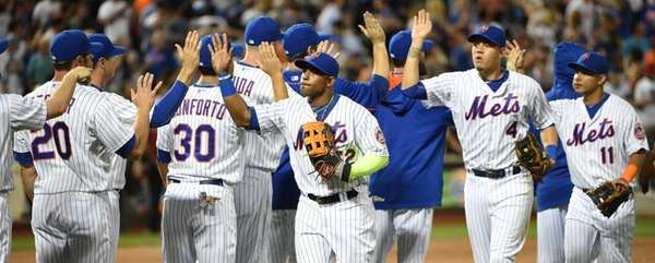 The New York Mets, including leftfielder Yoenis Cespedes,