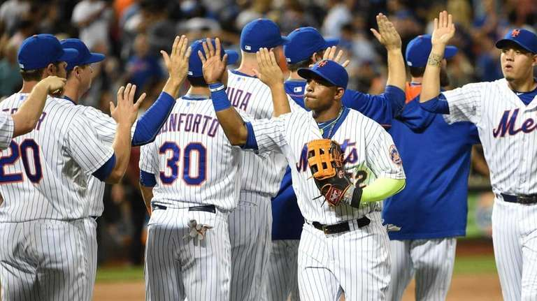 The New York Mets, including leftfielder Yoenis Cespedes,
