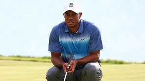 Tiger Woods of the United States waits on