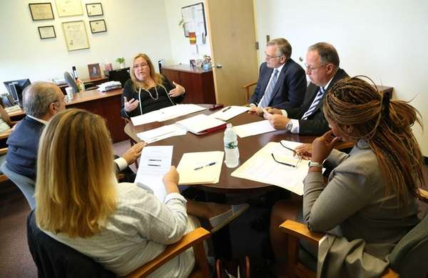 Members of Nassau County's Assessment Review Commission, which