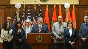 Nassau County Executive Edward P. Mangano, surrounded by